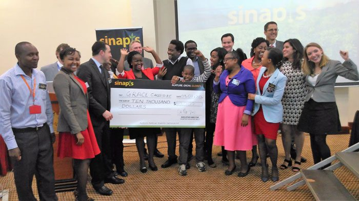 Grace Murugi'sjoy as she received the USD 10000 seed capital forher winning business plan competition to go to her bakery company