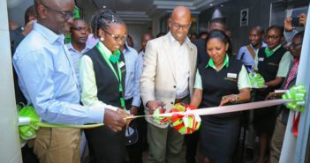 Safaricom CEO, Bob Collymore, cuts a ribbon to officially open the new Rift Region Safaricom Headquarters in Nakuru Town. With him is, Safaricom Director- Regional Sales and Operations, Steve Okeyo and other Safaricom staff.