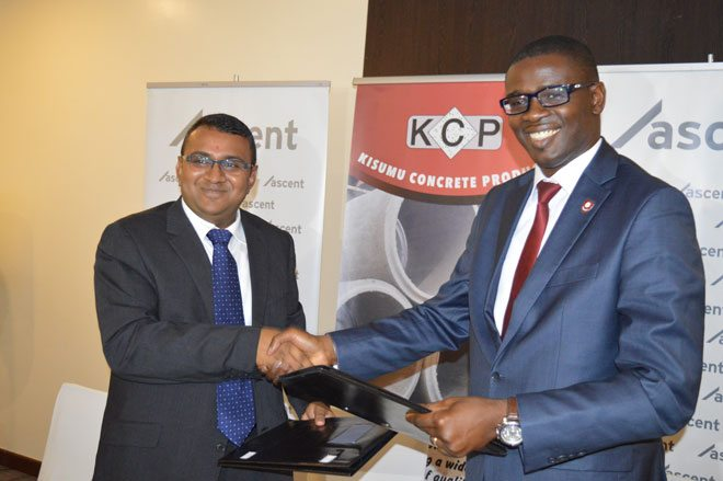 David Owino, Managing Partner at Ascent Capital Advisory Services LLP (Right) and Vimal Rabadia, CEO of Kisumu Concrete Products (Left) shake hands after signing the new Private Equity Partnership. Ascent has invested a significant amount in KCP. The announcement was made on Thursday, March 16, 2017 at Acacia Premier Hotel,Kisumu.