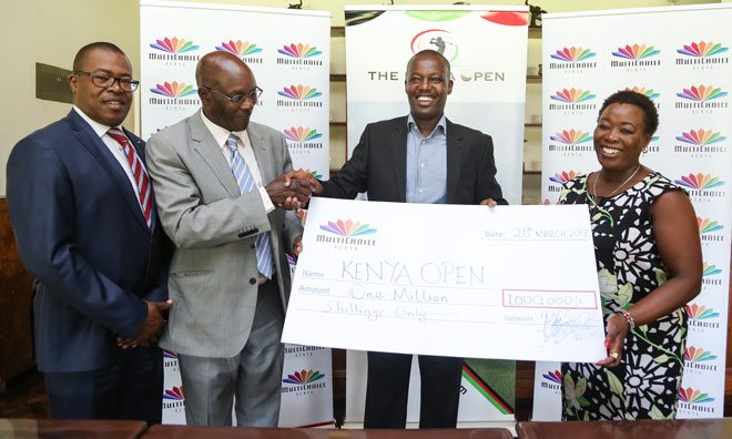 Multichoice Kenya, Corporate Communications Manager, Philip Wahome (second from right) hands over a Kshs. 1 million DStv sponsorship to the Chairman of the Kenya Open Golf Limited – Peter Kanyago (second from left). Looking on is Kenya Golf Union Chairman Muchau Githiaka and Sponsorship director Kathleen Kihanya.