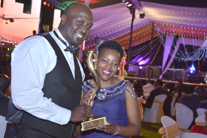 Ciru Ngigi – Regional Director (Right) & Canot Odawa - Account Director receive Best Marketing Promotion Campaign in the Experiential Category at the MSK 2015 Gala Awards (for the Launch of Downy Fabric Softener – Procter & Gamble)
