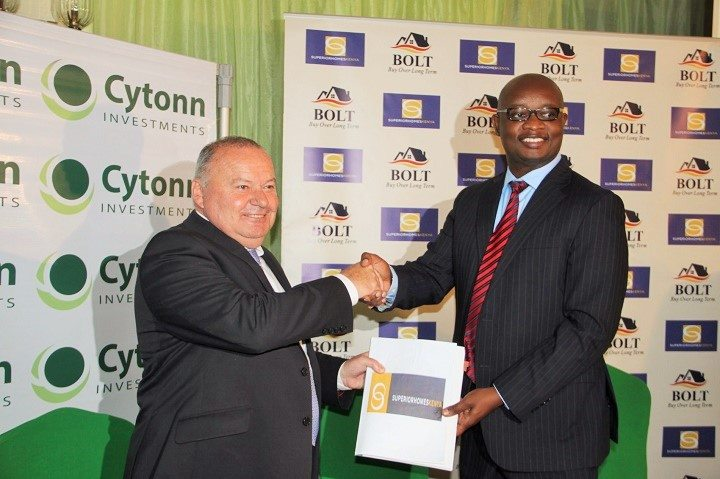 Ian Henderson, Managing Director of Superior Homes and Edwin H. Dande, Cytonn's Managing Partner and Chief Executive Officer shake hands after signing the partnership agreement.