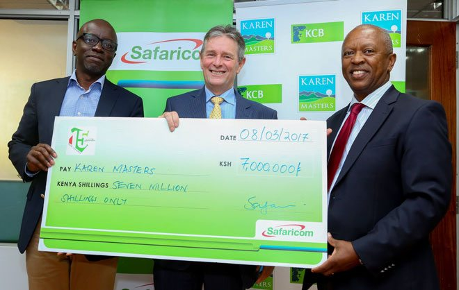 Steve Okeyo - Director, Regional Sales and Operations, Safaricom hands over a dummy cheque of KES 7 million to Andy Watt - Karen Masters Tournament Director and Sam Mwai - General Manager, Karen Country Club, in sponsorship of the upcoming Karen Masters Golf tournament.